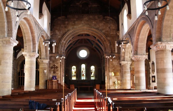 Looking down the nave to the altar in St Michael's Church. Note the wonderful Norman arches down the aisles and above the entrance to the chancel.