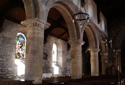 Some of the stained glass and Norman columns in St Michael's Church.